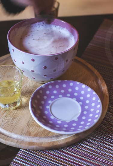 Milk and honey in bar. Violet color cup. Bulgaria photo