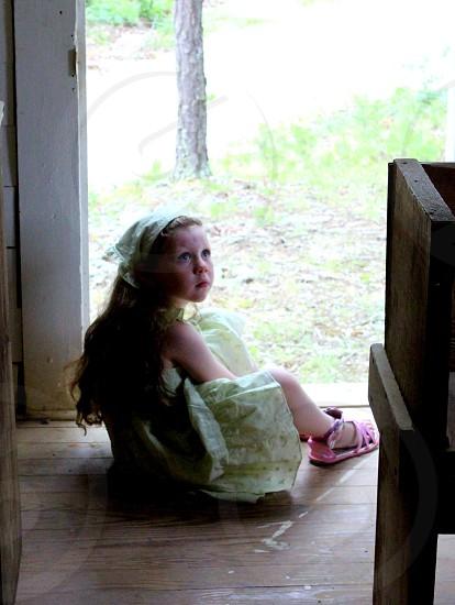 Girl in doorway of church photo