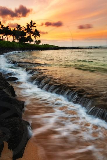 A beautiful sunrise at the beach on the south shore of Kauai Hawaii. photo