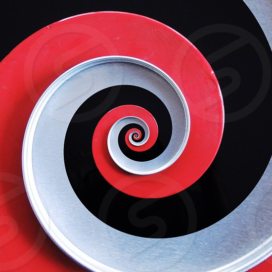 black red and white spiral art photo