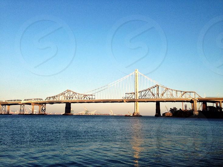 Old and new Oakland-San Francisco Bay Bridge photo
