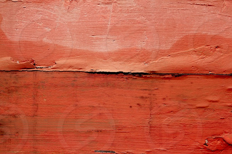 aged weathered wood painted in red orange color background texture photo