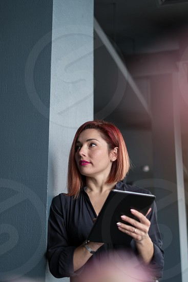 Well dressed business woman using tablet photo