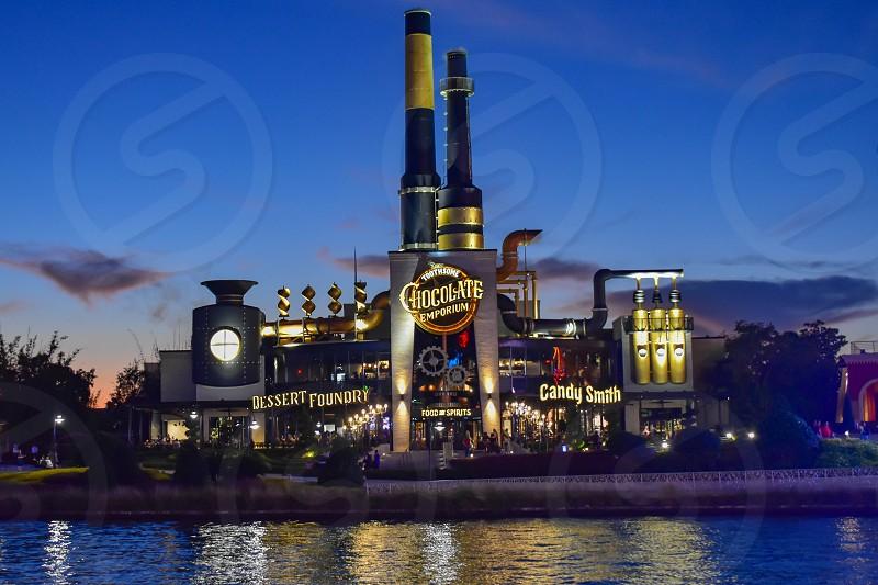 Orlando Florida. February 05 2019. Chocolate Emporium Restaurant on blue night background in Citywalk  at Universal Studios area. photo
