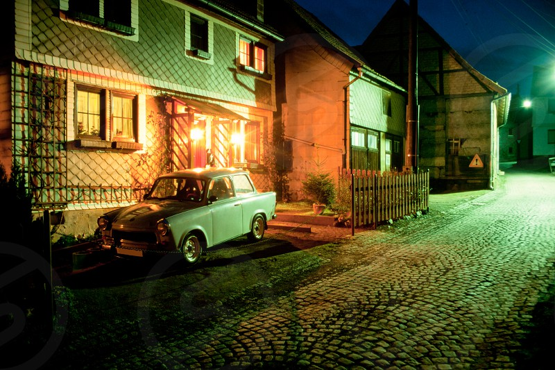 Trabant car parked at night in a small village in Thuringia Eastern Germany Europe a few years after reunification photo
