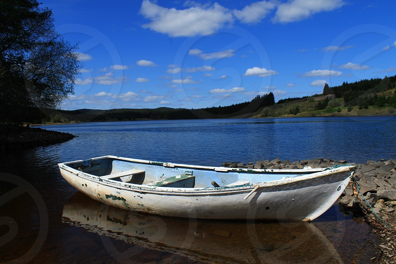 An old boat on he Black Esk reservoir in south west Scotland.. photo