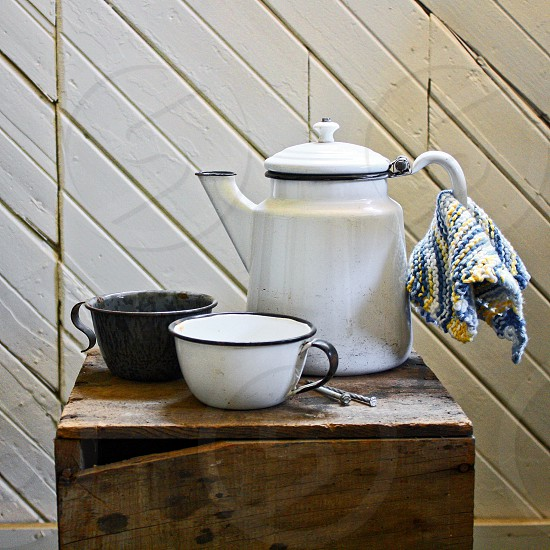 Set of retro and vintage enameled pteapot and cups photo