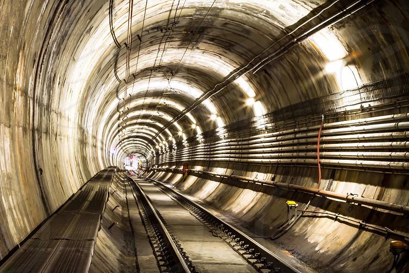 train tracks inside tunnel photo