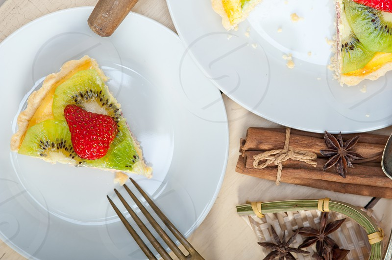 kiwi and strawberry pie tart with lemon custard cream and spices photo
