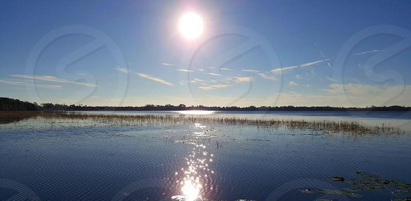 sunset lake sun reflection water reflection lake nona photo
