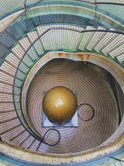 brown round decor under spiral stairs photo