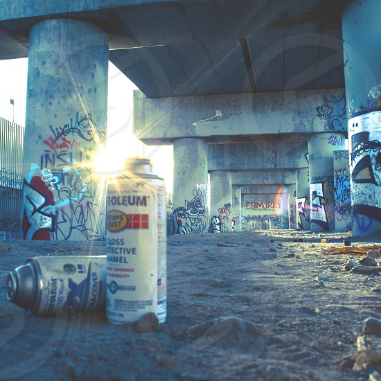 lens flare sun color urban decay cans paint grafitti art street dirt mood youth rebel photo