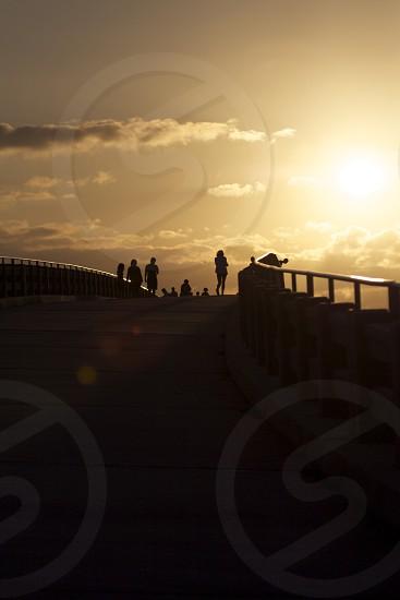 People walking at sunset. photo
