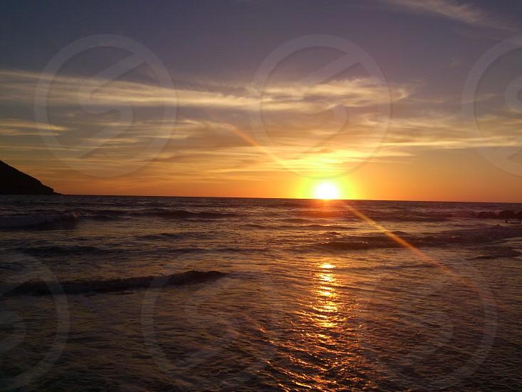 beach sunset sea sky clouds afternoon Mazatlán Sinaloa photo