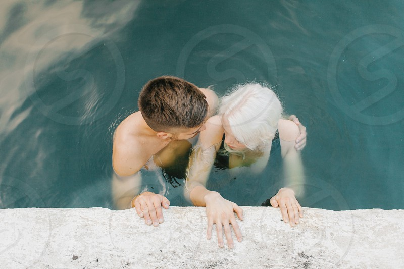high angle photo of couple swimming on body of water photo