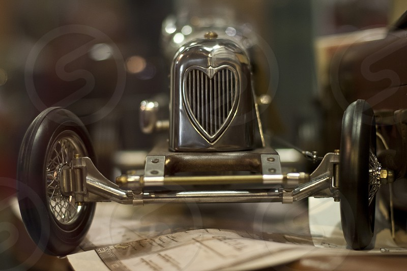 close up of metal toy car (roadster) with heard on front grill. photo