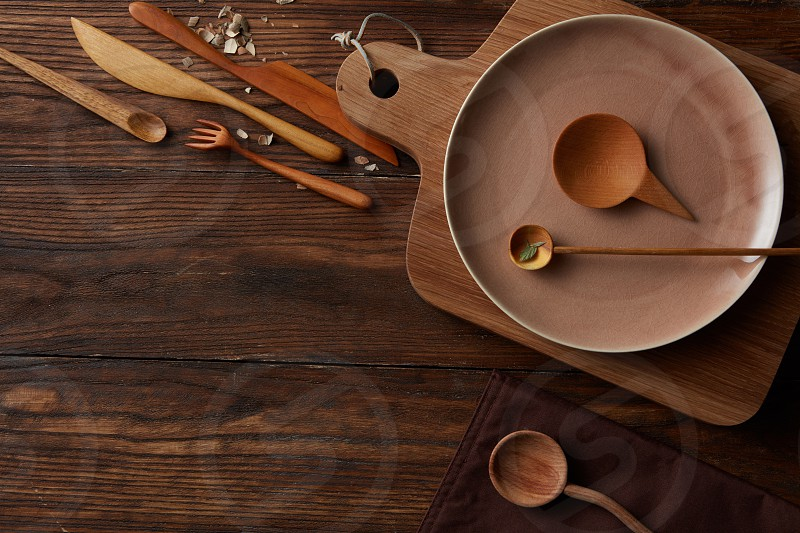 Rural vintage wood kitchen table with place for text and cooking utensils around. Country background with free recipe text space. photo