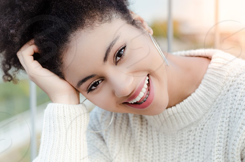Young beautiful  woman smiling to the camera! photo