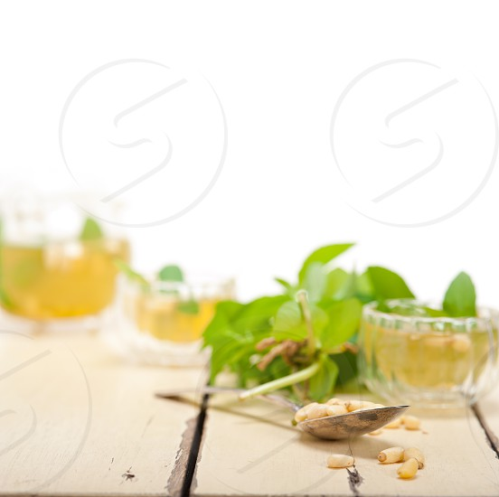 Arab traditional style  mint and pine nuts tea called  at tay photo