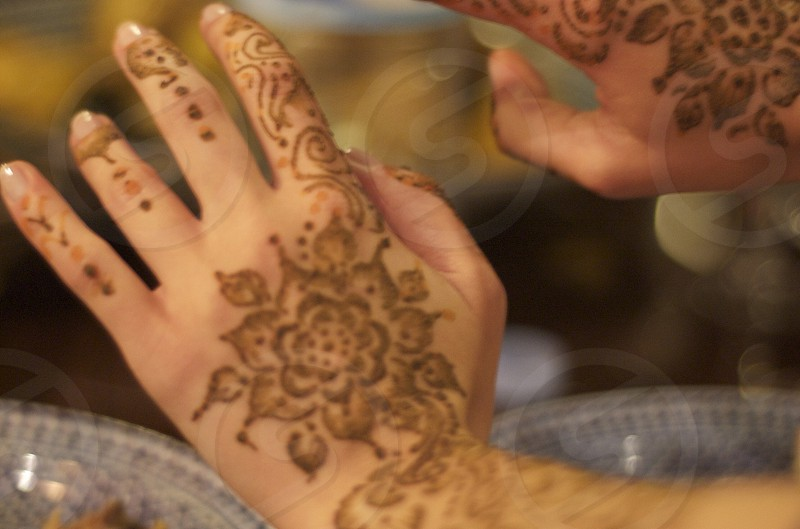 Hennaed hands in the medinas of Fes Morocco. photo