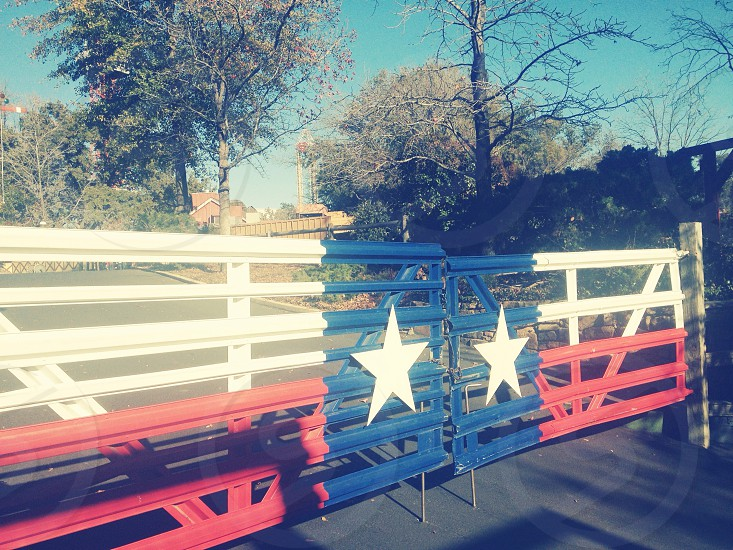 white blue red wooden fence with 2 stars  photo