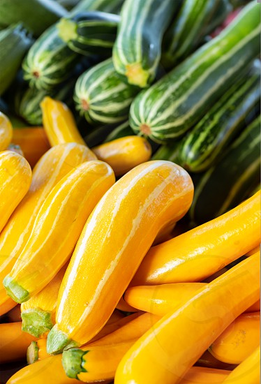 Close-up of Yellow and Green Striped Zucchini at a local market photo