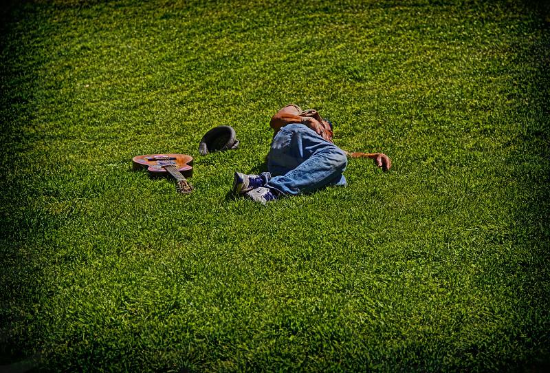 napping musician sun photo