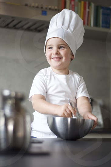 Child smile cooking photo