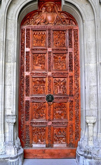 Church gate with woodcarving photo
