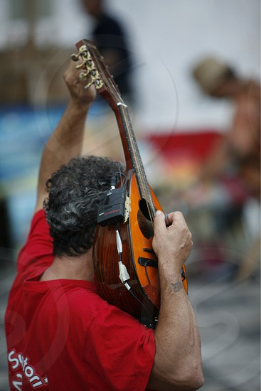 streetmusic in the old Town of  Taormina in Sicily in south Italy in Europe. photo
