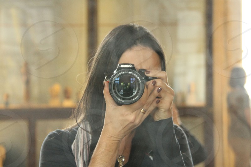 woman taking a picture photo
