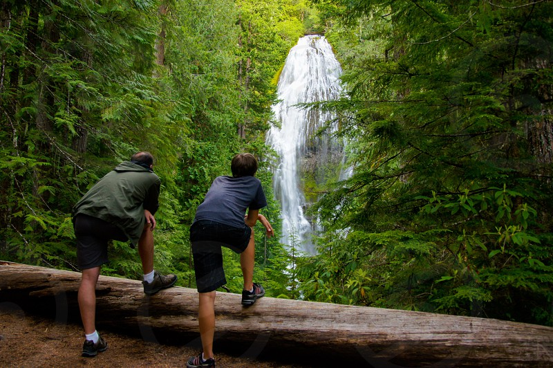 Waterfall father son look watch together moment Oregon proxy falls photo