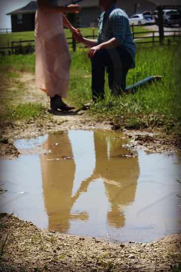 country engagement puddle reflection photo