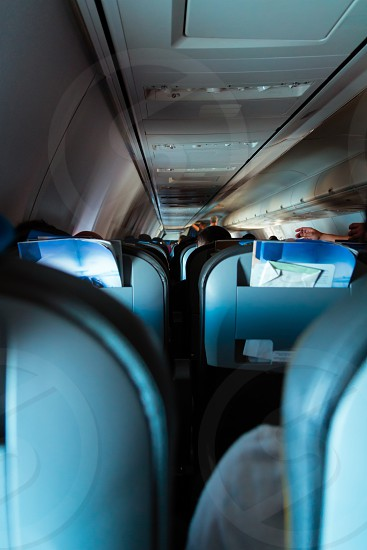 Interior of passenger airplane with people on seats. photo