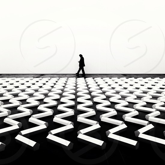 silhouette walking across zig zag lights  photo