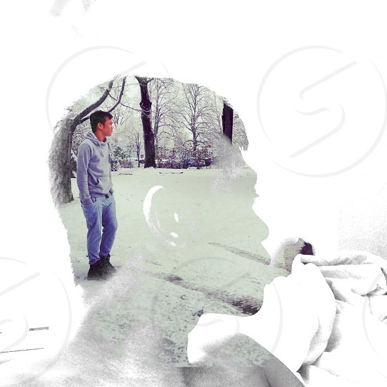 man in snow in gray hoodie and light blue jeans photo