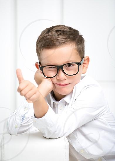 Smart boy kid funny joy happy boy home school  photo
