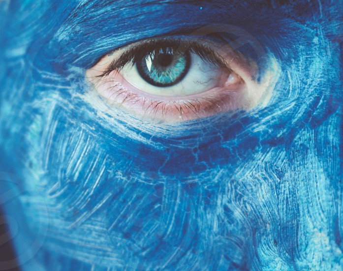 Beautiful Blue Eye Surounded By Blue Face Paint By Hannah Mcconnell Photo Stock Snapwire
