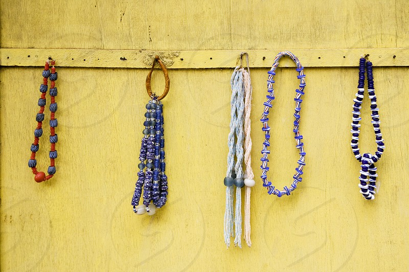 Necklaces at an outdoor market in Ghana photo