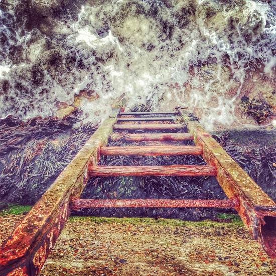 Seaside travel waves weather rust reflection ladders photo