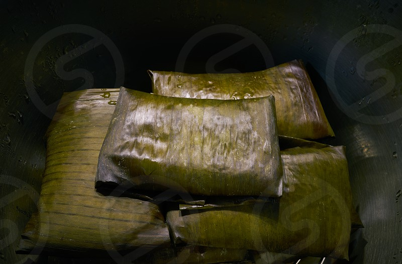 Tamale Mexican food recipe with banana leaves steamed photo
