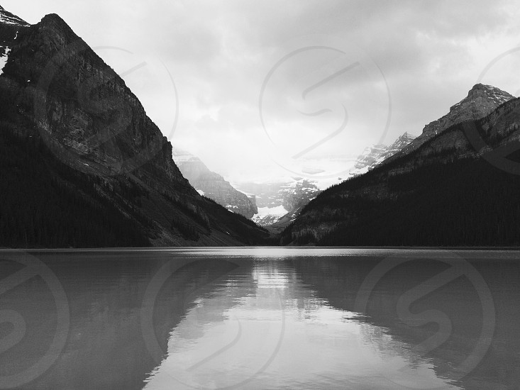 grayscale photo of body of water photo