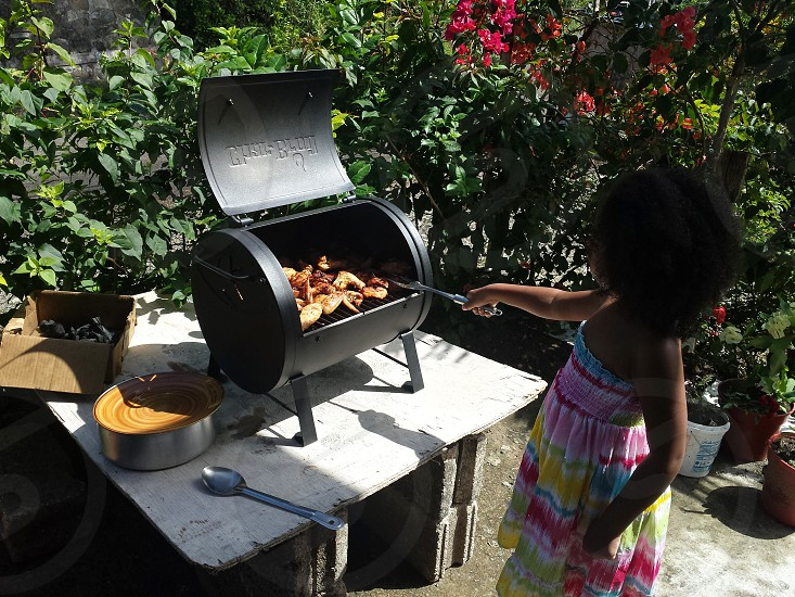 My baby grilling up a storm photo
