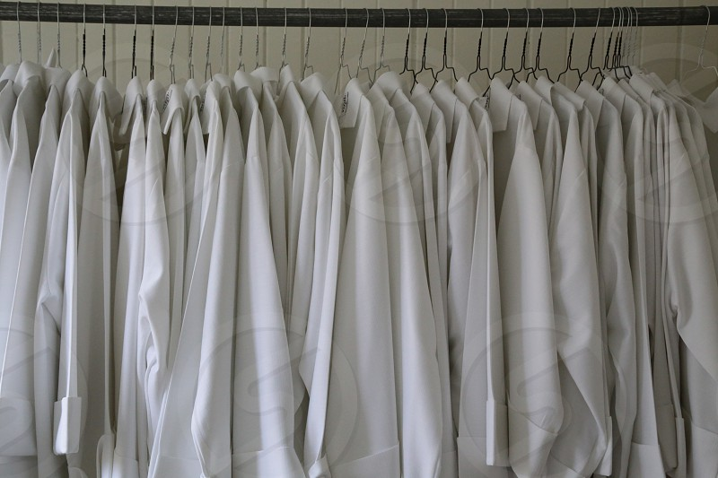 Whitedress dresses confirmation  hangers hanger similar  wardrobe  clothes church linen cotton believe faith priest  priests background wallpaper  photo