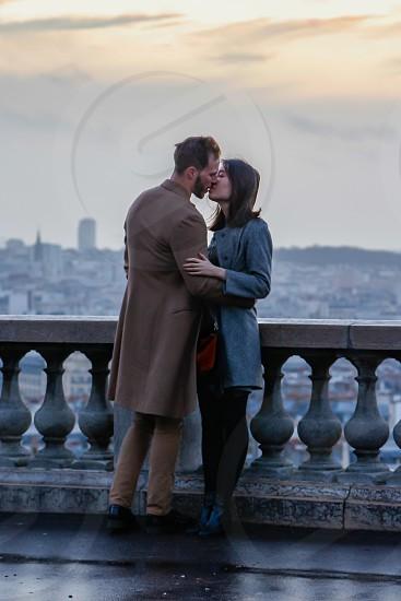couple kissing at dawn in Paris photo