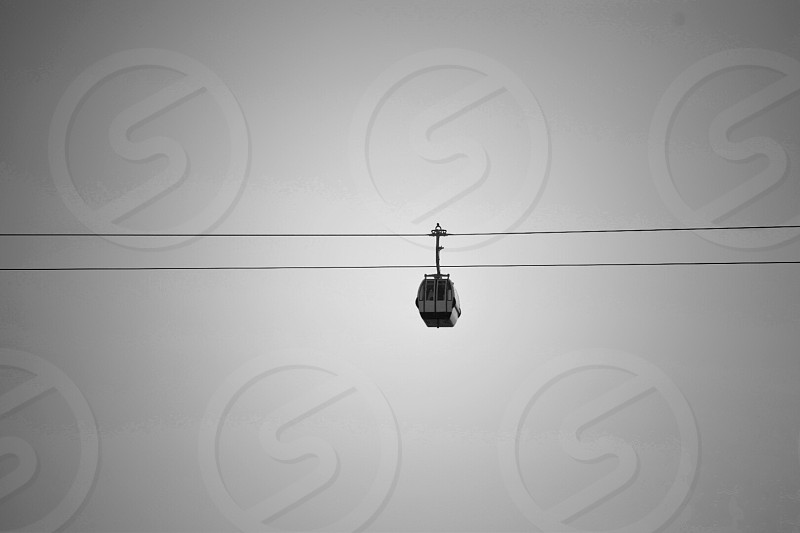 white cable car under gray sky during daytime photo
