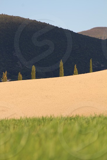 beige sand near mountain photo