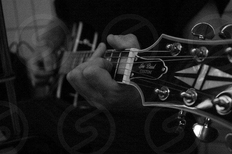 Guitar player's hands and quitar photo