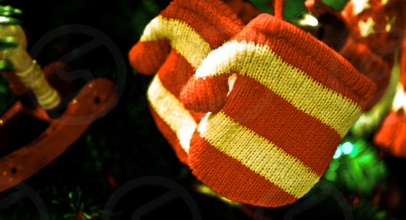 white and green knitted mittens photo