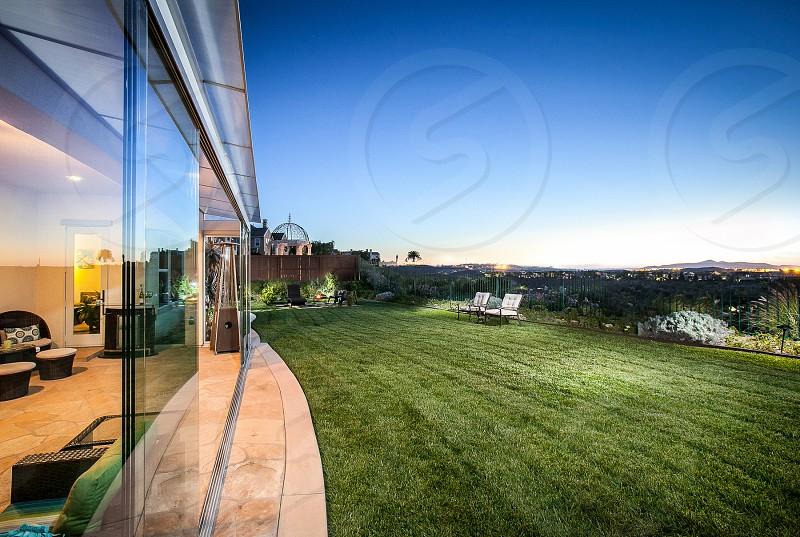 A luxurious family home in Southern California. House residence neighborhood suburban property yard.  photo
